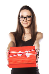 positive smiling girl giving a gift box
