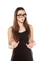 young woman with spectacles with a gesture of regret