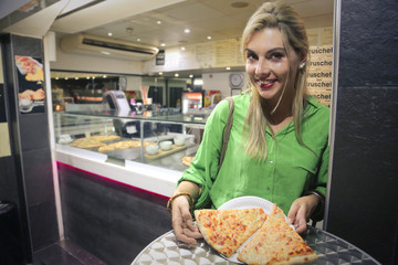 woman with a takeaway pizza