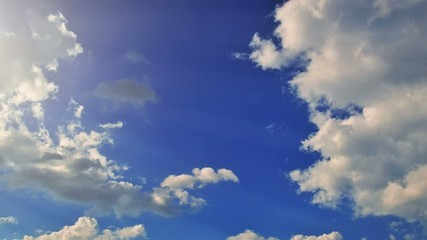 Moving beautiful clouds on a blue sky, timelapse