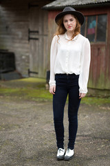 Beautiful Ginger Teenager In Front Of Stables