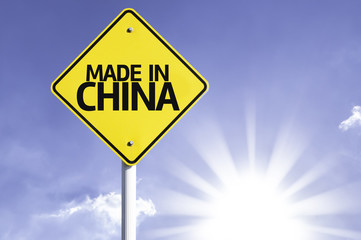 Made in China road sign with sun background