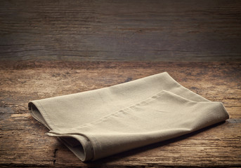 linen napkin on wooden table