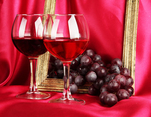 composition of frame,wine and grapes on bright background