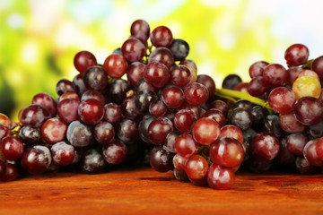 Fresh grape,on wooden table, on bright background