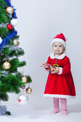 Christmas baby girl in a cap of Santa Claus