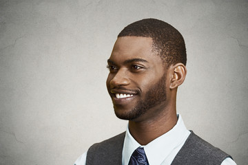 Closeup side view portrait, headshot handsome happy business man