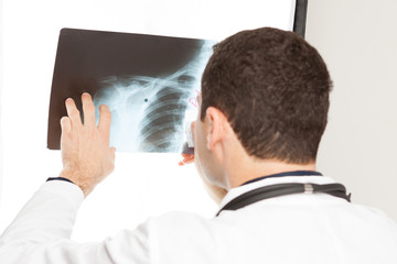 doctor holds X-ray
