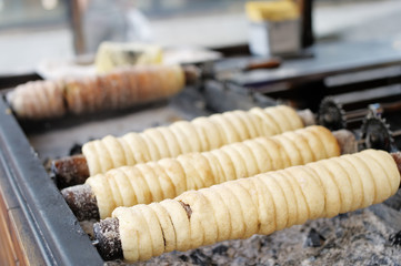 Baking of czech trdelnik