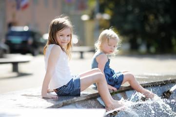 Girls having fun in a fountain