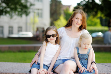 Young mother and her daughters outdoors