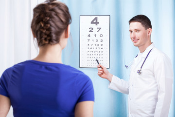 Doctor checking patient vision