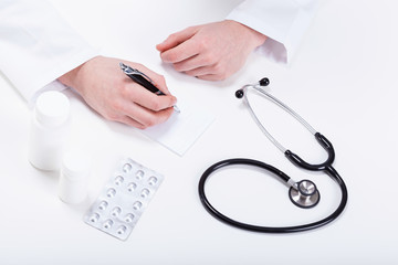 Doctor prescribing medicines to patient