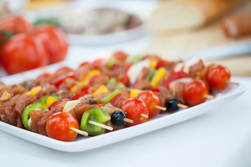 Delicious skewers on barbecue