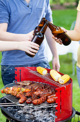 Friends grilling and drinking beer