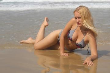 Beautiful blond posing sexy at the beach