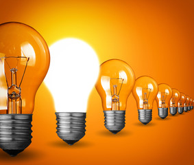 Idea concept with light bulbs on orange background