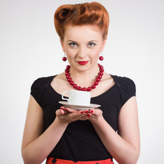Portrait of a beautiful woman with a cup of coffee.