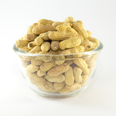 Roasted peanuts isolated in white glass bowl