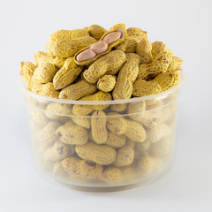 Open Roasted peanuts isolated in white plastic bowl