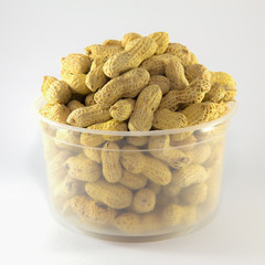 Roasted peanuts isolated in white plastic bowl