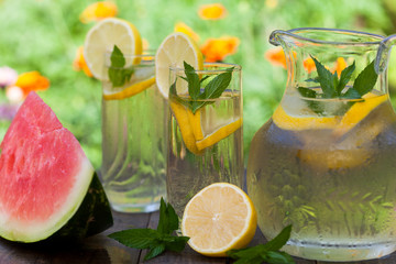 Cold lemonade with ice and mint