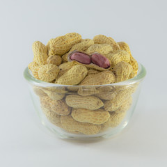Open Roasted peanuts isolated in white glass bowl