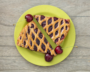Fresh backed cherry pie  on wooden table