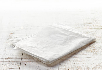 white wrapping paper on wooden table