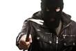 Criminal thief or burglar man in balaclava or mask holding crowb