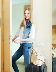 Blonde positive woman looking door