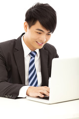 happy young business man using a laptop
