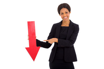 mature african businesswoman holding red arrow
