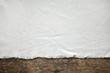 Leinwanddruck Bild - old white cotton tablecloth on wooden table