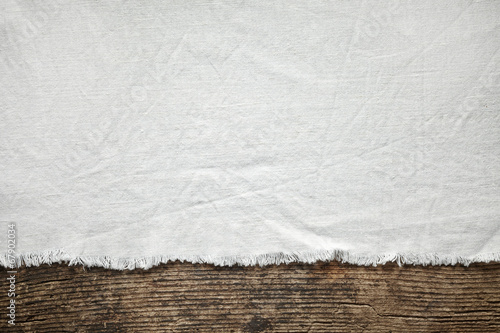 old white cotton tablecloth on wooden table - 67902034