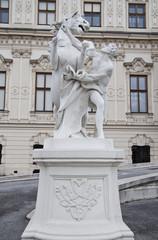 Statue of horsetamer in Belvedere gardens in Vienna