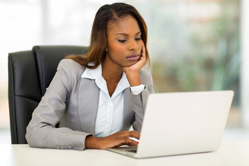 young african businesswoman looking at the laptop screen