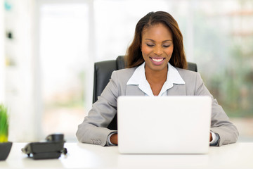 afro american businesswoman using laptop computer