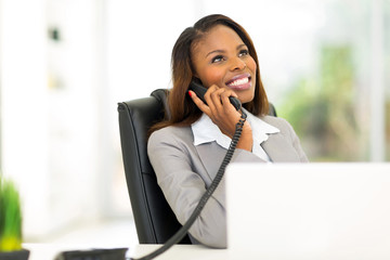 african businesswoman talking on the phone
