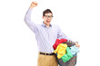 Cheerful man holding a laundry basket