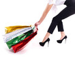 Attractive woman drags shopping bags.