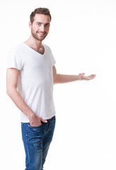 Young smiling man shows something on arm.