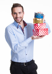 Portrait of happy young man with gifts.