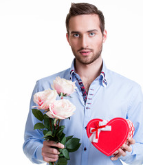 Young man with a pink roses and a gift.