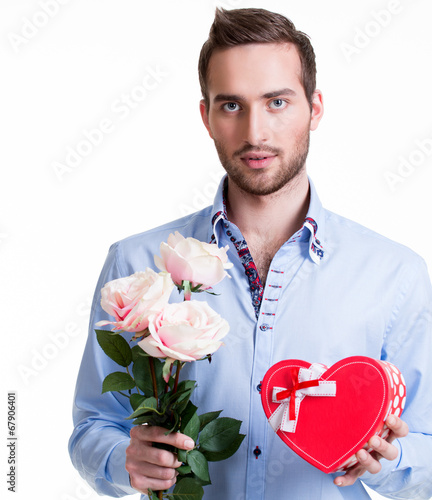 canvas print picture Young man with a pink roses and a gift.
