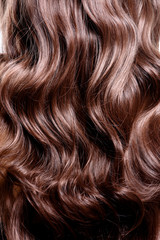 Back view of brunette woman with long black curly hair.