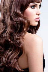 Beautiful woman with brown curly hairs.