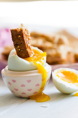Opened boiled blue duck egg with soft yolk with toast soldier di