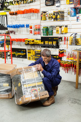 Worker Lifting Tool Package In Hardware Shop