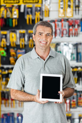 Man Displaying Digital Tablet In Hardware Store